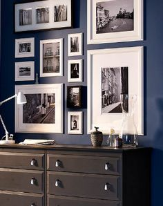 A great example of what dark wall color and white frames/mats will look like hung gallery style.