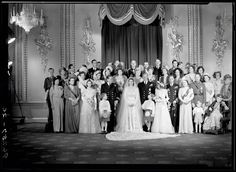 Photo by Bassano Ltd on 20 Nov 1947 of the Royal Wedding Party of future Queen Elizabeth II (Elizabeth Alexandra Mary) (21 Apr 1926-living2016 age 90) UK & Prince Philip Mountbatten (10 Jun 1921-living2016 age 95) Greece in the Throne Room, Buckingham Palace, London, UK. Located 2016 UK National Portrait Collection NPG x158911.