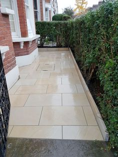 Newly fitted sandstone paving creates a clean finish for this London Front Garden project. Stone Garden Paths, Garden Paving, Garden Stones, Garden Slabs, Patio Slabs, Patio Flooring, Cottage Patio, Pool Landscape Design, Garden Design