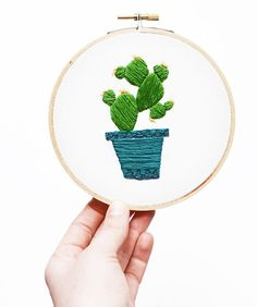 Sarah Benning's Cactus in a Blue Geometric Planter embroidered artwork, available to purchase from her Etsy shop.