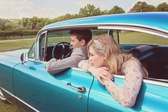 Bride and groom in blue cadillac