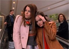 Lorelai and Rory hiding from Emily at the mall