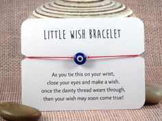 Need an order larger than 10? See the BULK DISCOUNT section at the bottom of this description! **As you tie this on your wrist, Close your eyes and make a wish. When the dainty thread wears through, Then your wish may soon come true!** Each card contains one wish bracelet with an evil eye bead on cotton thread in your choice of several colors. The Evil Eye (Nazar, Mati, Mal de Ojo, or Drishti) is a symbol used in cultures around the world that is said to ward off evil or jealous looks, ...