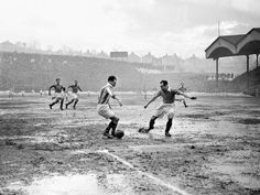 Charlton and Hudderfield play out their Division One game on a dog of a pitch, 1947