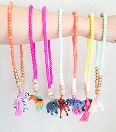 Each necklace is made from wooden and glass beads. The neon, wood and gold are sure to add a bright spot of color to your little one's getup and the animal friend will give them friendly company.Kiddos love bright colors and animals so why not put them together on one sweet necklace with a soft tassel to bring it all together!I hunted down the little animal figurines from the local swap meet and cleaned them up. So each animal is being given a second chance :)