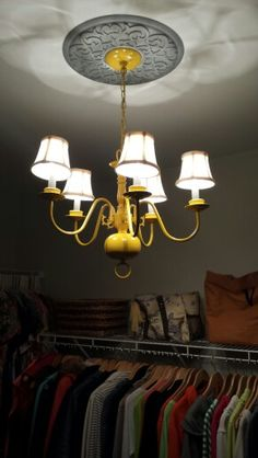 I painted a brass chandelier that I found at a thrift store Canary Yellow! I added a floral embossed medallion that I painted grey with a wisp of silver paint...and now it's One of a Kind.