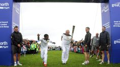 In this handout image provided by LOCOG, Torchbearer Haile Gebrselassie and Torchbearer Brendan Foster cross the Great North Run finish line with the Olympic Flame on the Torch Relay leg between. Get premium, high resolution news photos at Getty Images Olympic Flame, Great North, Local Hero, Newcastle, The Fosters, Olympics, Athlete, Ethiopia, Day