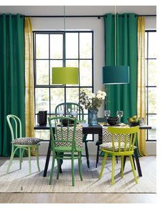 Green living room color scheme. Green painted chairs and green curtains.
