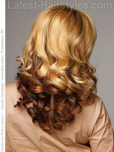 What a contrast! Those curls are amazing. Reverse ombre hair color, beautiful.