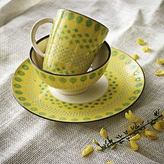 "Potter's Workshop Tableware – Yellow from West Elm. Yellow, White,  kitchen color combinations. ""This set is a result of our collaboration with Potter's Workshop, a collective of South African artists known for their signature bead-like patterns,  in China who hand-paint each piece. Workshop, while maintaining the integrity of their process and bringing their designs to a global audience at a great value"" yellow bowl yellow plate yellow dinnerware"