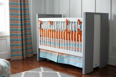 Inside the nursery of @Carousel Designs' Leah Sicat. Beautiful orange, gray and blue chevron crib bedding!
