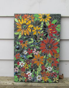 Gorgeous mosaic flower plaque...maybe I'll do something like this someday! LOL