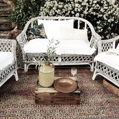 Our cane lounge suite with its classic white cushions, can be coordinated with your theme with a few additional cushions and a rug of your choice. So versatile... We love it!