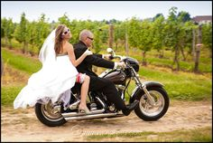 A fun way to arrive at your wedding reception - on a Harley :) Newlyweds are both police sheriffs and motorcycle enthusiasts. Even their cake topper looked much like this. The bride wasn't afraid to get her wedding dress dirty. Photo by Kristina Stockton © photokisses.com