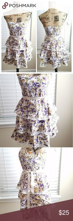 B. Smart purple floral dress size 10 Beautiful purple floral strapless dress with ribbon sash and layered skirt, size 10, great condition. All my items are clean and are kept in a smoke free, pet free environment. Dresses Strapless