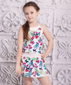 This comfy cotton dress is infused with the charm of a butterfly print. The drop-waist cut and sleeveless silhouette create a sweet and sassy look.