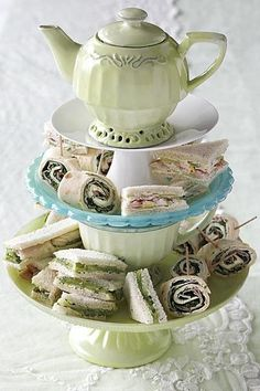 English afternoon tea sandwiches and wraps. Love the teapot on top!