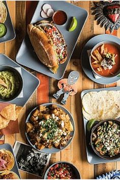 Plates of Mexican food on a table Best Restaurants In Edmonton, Ebi Tempura, Watermelon Bowl, Kid Friendly Restaurants, Fried Oysters, Japanese Curry, Singapore Food, Angus Beef, Mexican Food Recipes