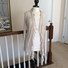 Light-weight Cardigan   Extra light, perfect 4 late Spring or early Summer night when there's just a little chill n the air... Very pretty, color is grayish-beige & has a lace panel across the back. Bought @ Cato's, says size XL but fits more like a Ł.  Tops