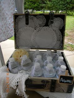 Vintage Shabby Chic - a really cute idea for a party.  I think I will use this idea for my craft room and use bottles or small containers and fill them with my beads.