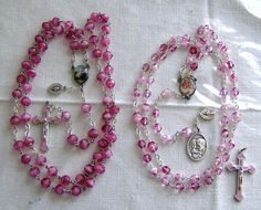 All sizes | Photo without flash: Similar rosaries: Left, acrylic rose-shaped beads with white lining; right: faceted glass beads with white lining., via Flickr.