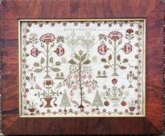 Victoria's Garden is the title of this reproduction sampler from Heartstring Samplery that is stitched with Classic Colorworks