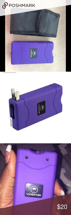 "Taser Taser w/ FREE Case - PURPLE Extremely Powerful 4 Prongs and 2 Spikes For Double Shocking and Penetrating Power Mini Size, Conceals Easily - Only 4-1/4"" tall, 2 1/8"" wide and 1"" thick - Slips easily into a pocket or purse.  Built in LED Flashlight & Built in Charger Rechargeable Battery  Safety switch prevents accidental discharges Lifetime Warranty  We do not ship to the following areas:  The following states consider them illegal: Hawaii, Illinois, Massachusetts, Michigan, New Jersey…"