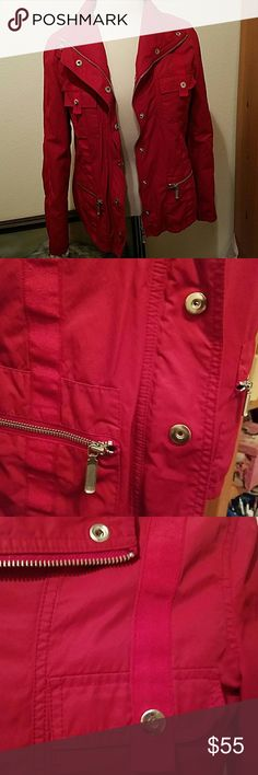 Red Cabi jacket So adorable and fits so flattering.   I love this coat but never wear it and I don't know why.  This is light weight, not quite a windbreaker but almost.  Perfect condition.   I am a size 10 and this fits me to perfection. CAbi Jackets & Coats Utility Jackets