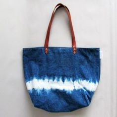 A collection of timeless hand-dyed indigo colour clothing, accessories and textiles for everyday wear. Crafted with eco-friendly and sustainable beliefs. Leather Handle, Real Leather, Leather Bags, Denim Tote Bags, Eco Friendly Bags, Over The Shoulder Bags, Textiles, Bags Uk, Shopper Bag