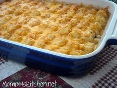Pour the soup mixture over on top of the ground beef layer spread evenly to cover the meat mixture. Top with tater tots, sprinkle with grated cheese over the entire casserole.    Bake at 350 degrees uncovered for 30 minutes or until the casserole is bubbly and cheese is completely melted.