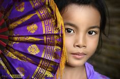 A young Balinese girl with her traditional fan, taken in Ubud, Bali, Indonesia david lazar photography
