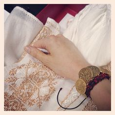 Romanian traditional blouse fitted with traditional golden coins bracelet designed by TRIA ALFA
