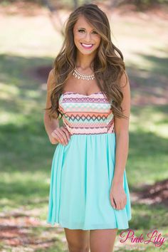 You'll be the life of the party anywhere you go in this beautiful dress! It features a chiffon skirt with lining underneath, a little padding in the bust, and a multi color print top! Pair with sandals and you're ready for the day!