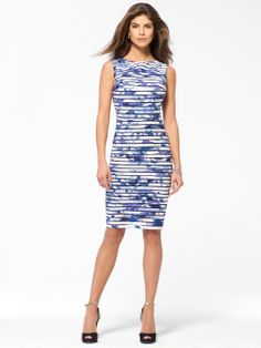 Sleeveless dress in our new Blue Roses print features sexy illusion stripes. Straight skirt with contoured silhouette. SleevelessLinedBack zipHook and eye closure 38 inch body length100% PolyesterComb