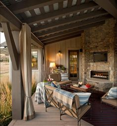 Love this outdoor curtain idea from HGTV 2012 Dream Home.