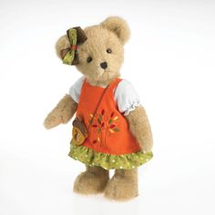 Autumn Fallsworth is ready to rake some leaves in her pretty orange corduroy jumper dress, complete with an embroidered tree design and polka-dotted ruffle trim. Her acorn-shaped sling purse completes her fashionable fall ensemble. Part of the collectors series from Boyds Bears®.