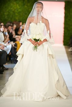 Brides.com: . Strapless lace and silk taffeta ball gown wedding dress with a sweetheart neckline, Oscar de la Renta