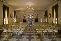Renaissance Event & Wedding Venue features include a 20 foot ceiling, marble floors, 8 stained glass windows, a gas fireplace focal point, 5 antique chandeliers and a decorative balcony overlooking the salon.
