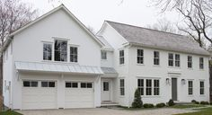 modern farmhouse exterior with columnless - roof/awning