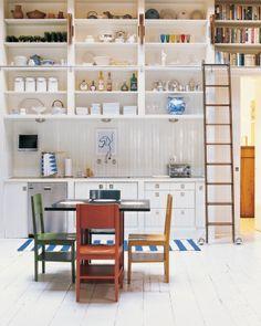 Recipe books above the doorway with a rolling ladder to reach them