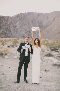 Dave Richards Photography newlyweds with signs // via ruffledblog.com