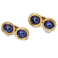 PAIR OF 18 KARAT GOLD AND CABOCHON SAPHPIRE CUFFLINKS, CARTIER, PARIS, CIRCA 1920 The links set with cabochon sapphires, within gold frames, signed Cartier, Paris, numbered R5628, maker's mark, French assay marks.