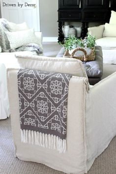 Great idea for adding color and texture to a space - add fringe to a favorite fabric and drape it over the back of a chair