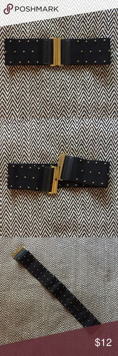 Black & Gold studded waist belt Cute wide stretchy waist belt. Black material with gold studs. Perfect to cinch a slouchy sweater or top a pencil skirt! Great condition. Accessories Belts