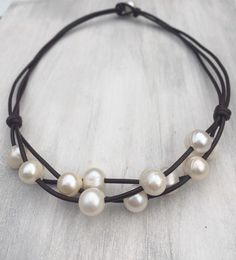Freshwater pearl necklace, leather and pearls, pearls on leather, pearl jewelry A personal favorite from my Etsy shop https://www.etsy.com/listing/266423024/multistrand-freshwater-pearl-necklace