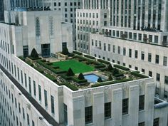 Achieving balance is easier in  formal gardens  because  they are set out in a symmetrical pattern as in this urban rooftop  garden, a surprising punch of green amidst city concrete.