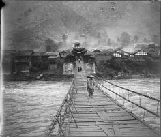 Auguste François, Crossing the Luding Bridge over the Dadu River in Luding County, Sichuan, China, circa 1886-1904