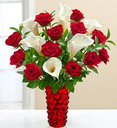 Classic red roses and exquisite Calla lilies pair as elegantly as Fred and Ginger, Romeo and Juliet, and (of course), you and your Valentine. Add a romantic vase and create another perfect pair. Get Well Flowers, Cheap Flowers, Love Flowers, Beautiful Flowers, Wedding Flowers, Romantic Flowers, Calla Lily Bouquet, Red Rose Bouquet, Calla Lillies