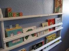 Wall front facing book shelves (made from a plate display)