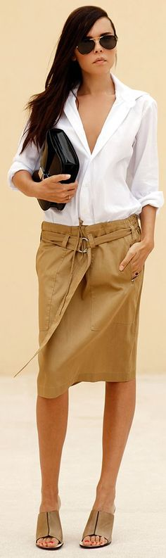 Celine camel leather knee length belted low rise skirt, white shirt, black purse, camel mules.